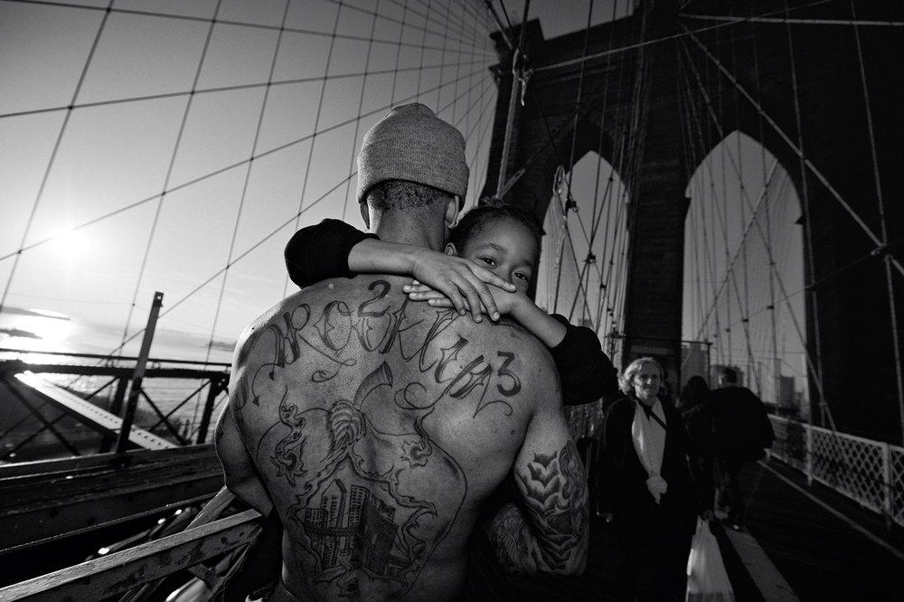 Zun Lee,  Jerell Willis carries Fidel across Brooklyn Bridge , Brooklyn, NY, 2012
