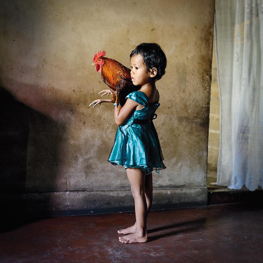 Karolin Klüppel,  Yasmin Holding a Rooster , 2015