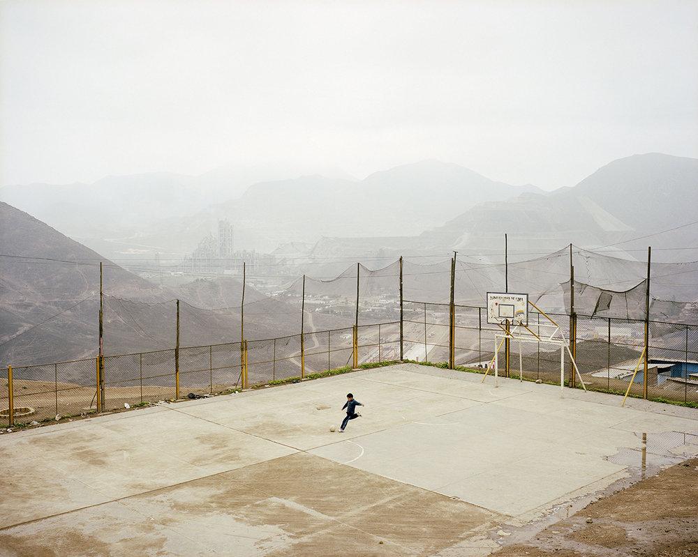 Noah Addis,  Luis Fernando Vasquez plays fútbol in the La Pradera Settlement, Lima , 2010