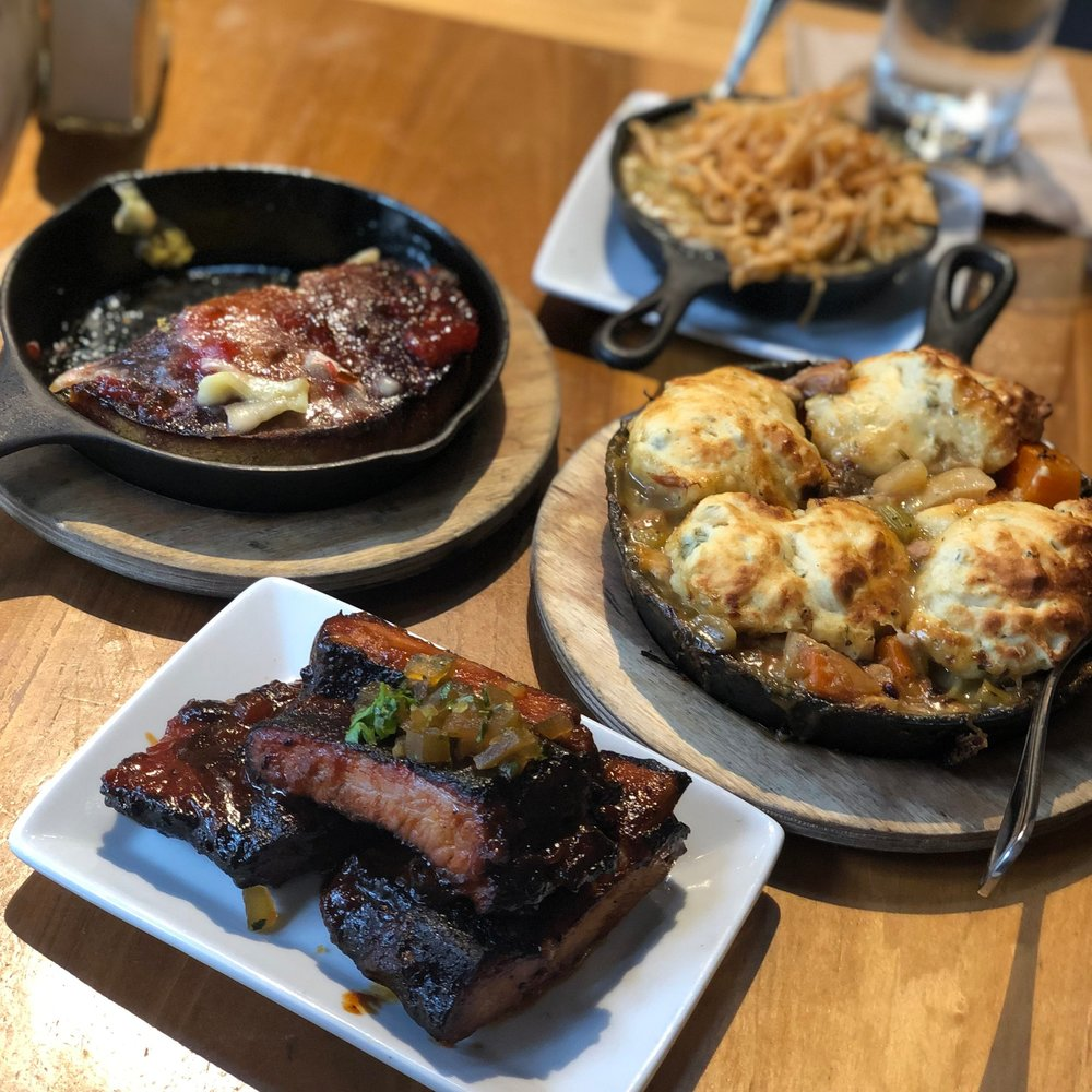 Ribs, rabbit, fried brussels, and cornbread skillet at Cochon