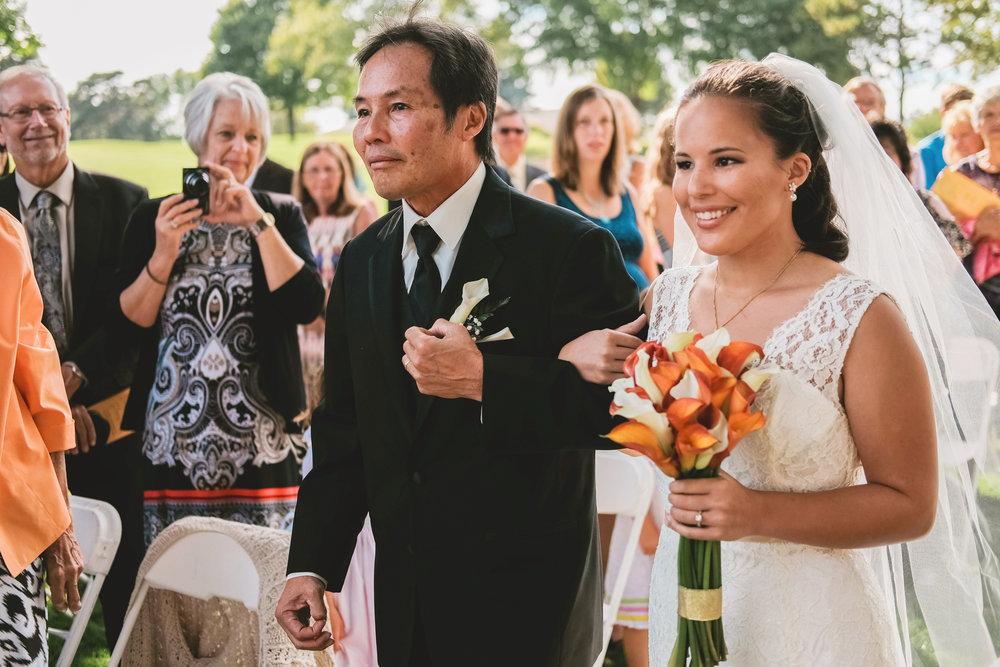 Photo of father walking bride down aisle in Oconomowoc, Wisconsin