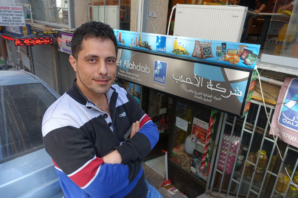 "Jihad Al Ahdab stands outside his small Syrian grocery store in the heart of Istanbul's ""Little Syria"". (Photo by Ansel Mullins)"