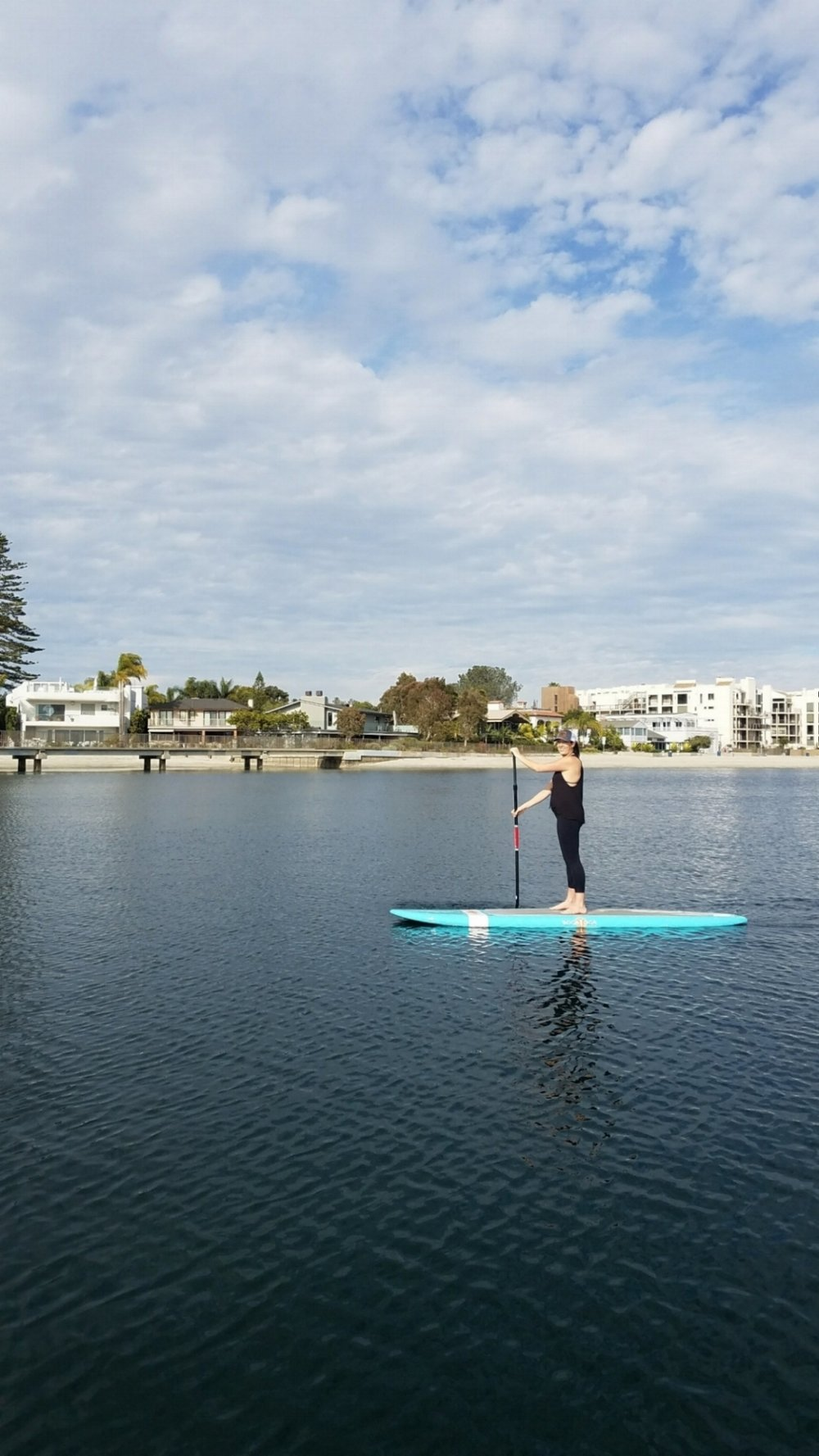 SunChaser SUP paddling out in Mission Bay - San Diego, California