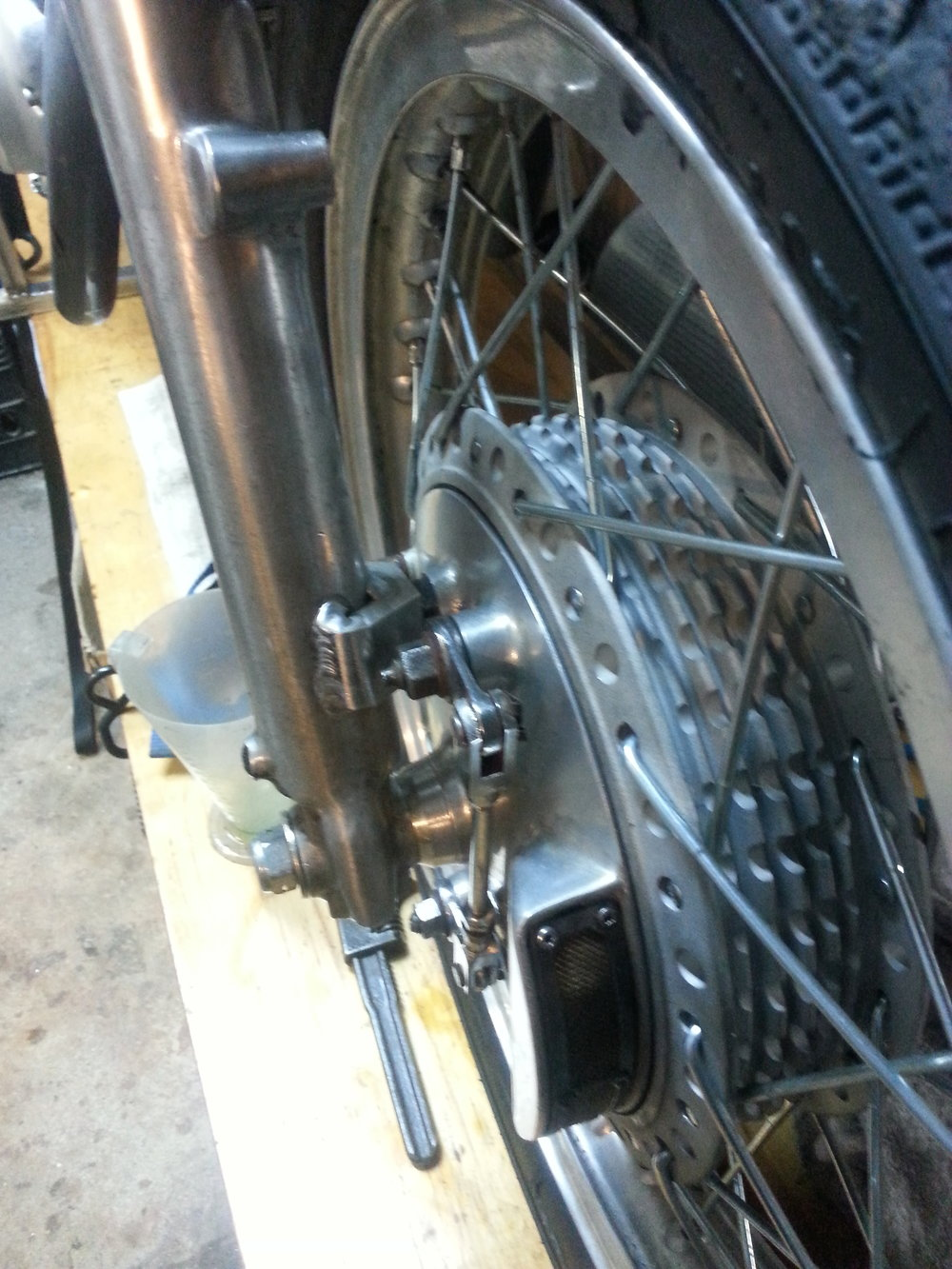 Norton 2LS brake adapted for road racing use on Itilian forks.