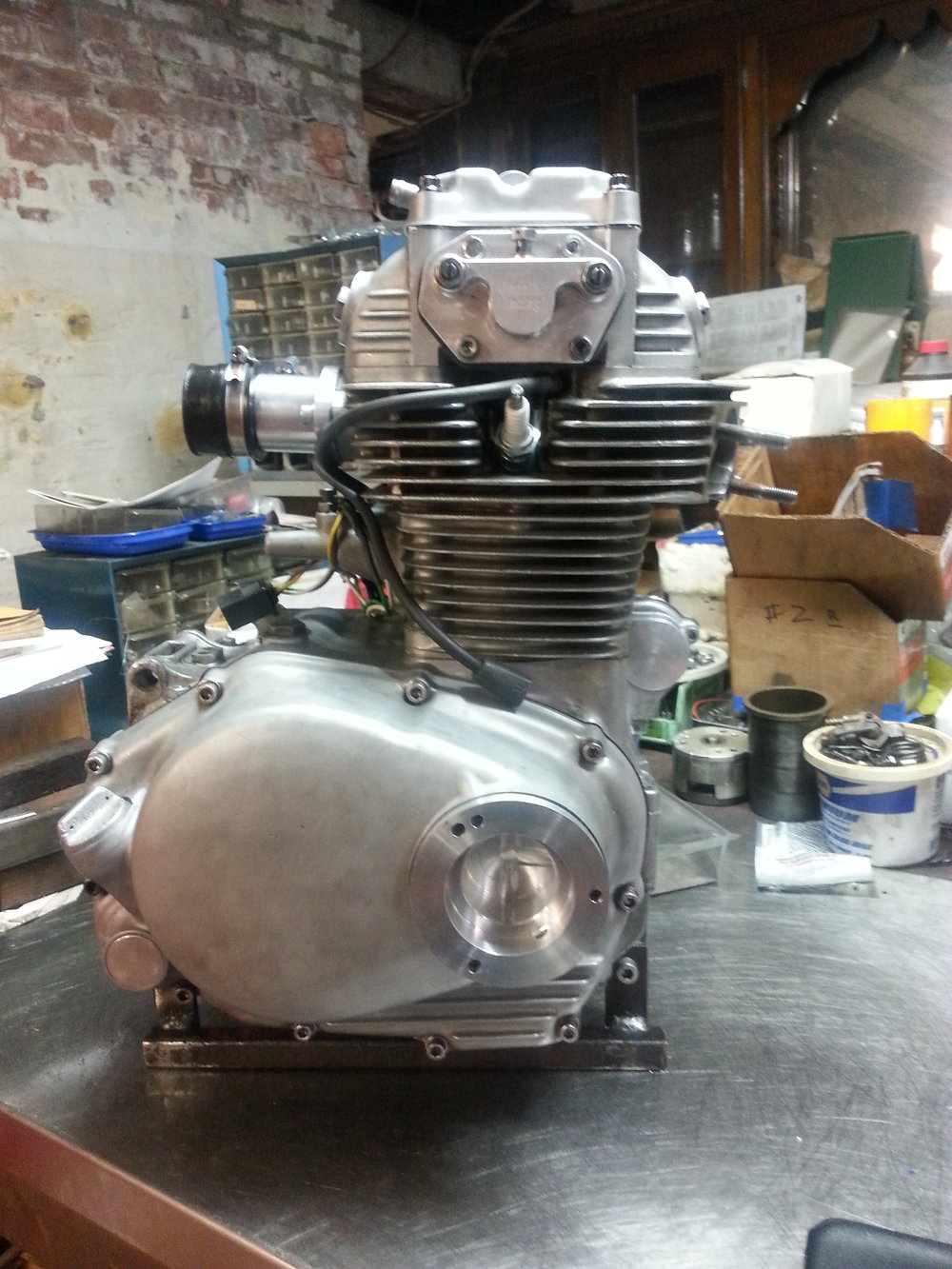 Custom oil filter housing installed on the CB350 Engine