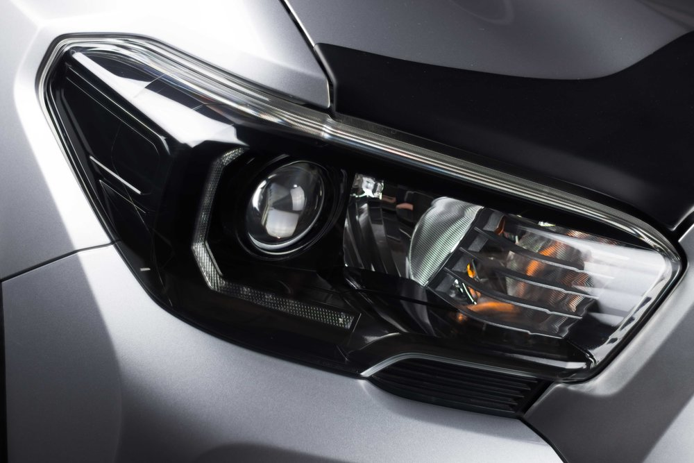 Housing Paint Work - We can paint the housings of almost any headlights! Perfect for those looking for something simple and clean,up to those that want fully color-matched lights! Painting the headlights will set the tone of your vehicles front end.