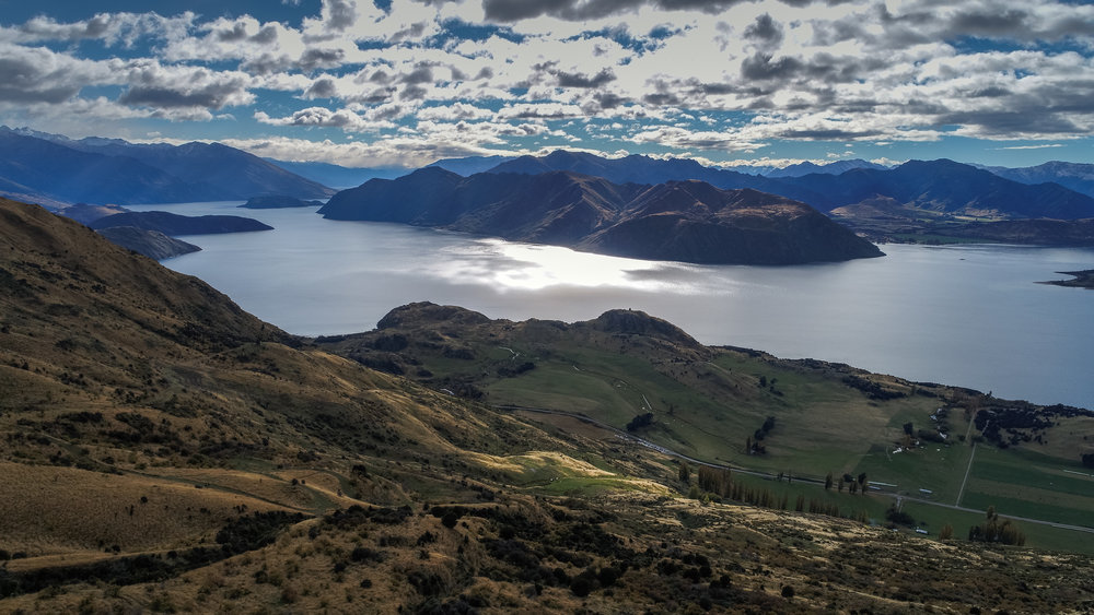 Flight with the drone over Lake Wanaka from Roys Peak