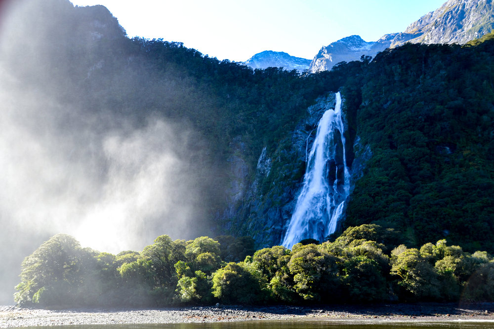 Huge waterfall in Milford Sound during boat tour