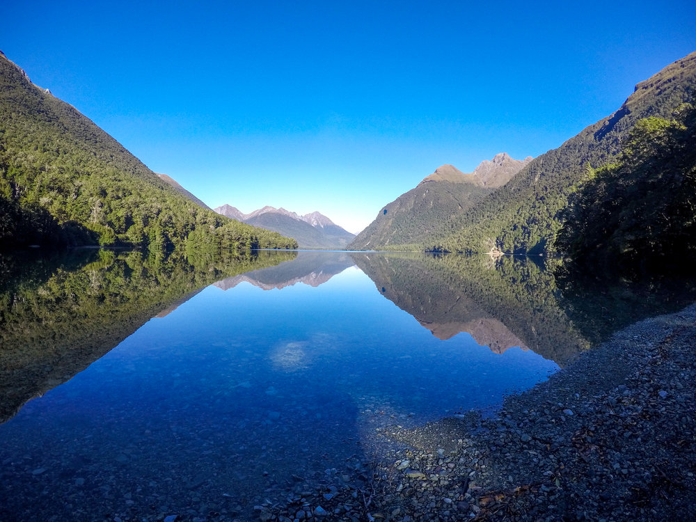 Reflecting Mirror Lake of mountains in Fiordland