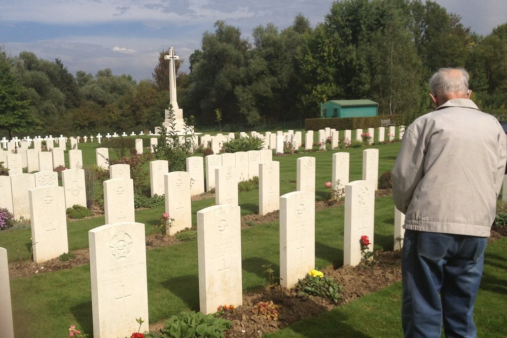 Barney Greatrex visiting the graves of his fallen crew mates in Choloy War Cemetery, France, in 2013.