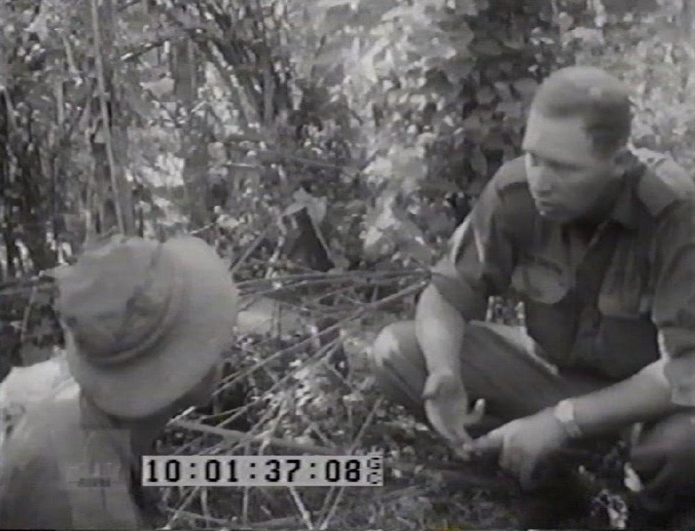 w. Capt MacGregor briefing a Tunnel Rat on Operation Enoggera.jpg