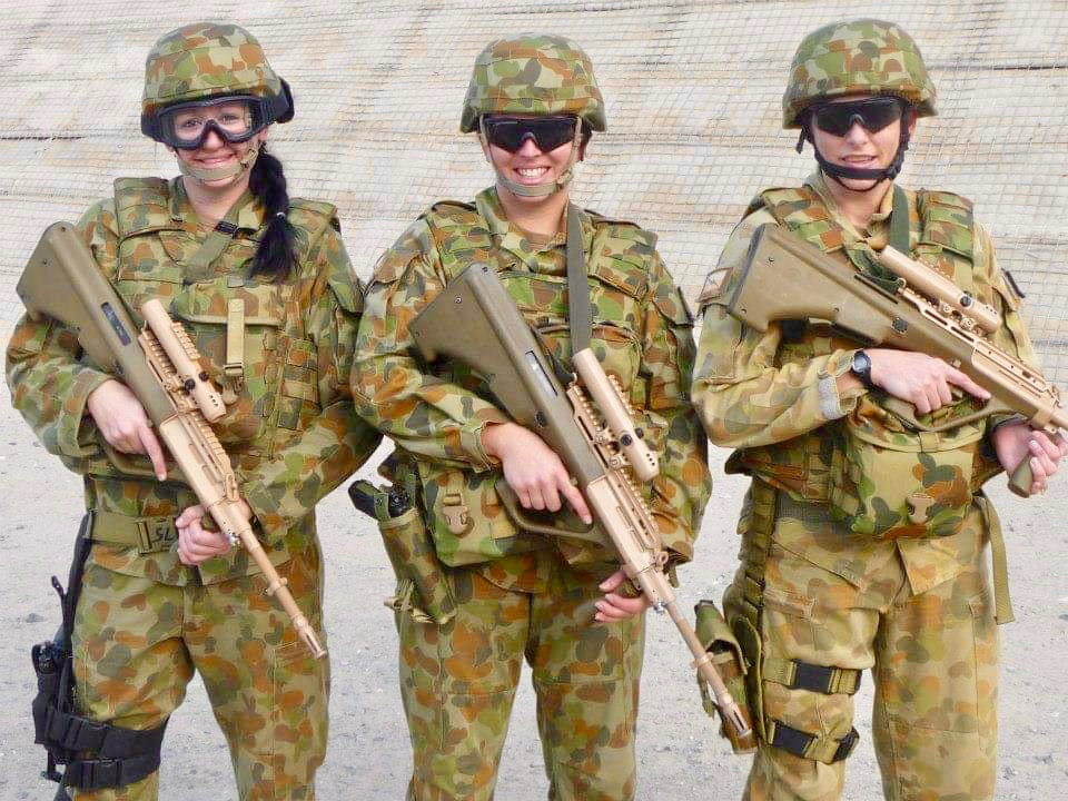 PIC 13    2012 – AL MINHAD AIR BASE (AMAB) – On the firing range – Steyr in hand with my CPL Clerk and my SGT (they called us Charlies Angels…..lol).jpg