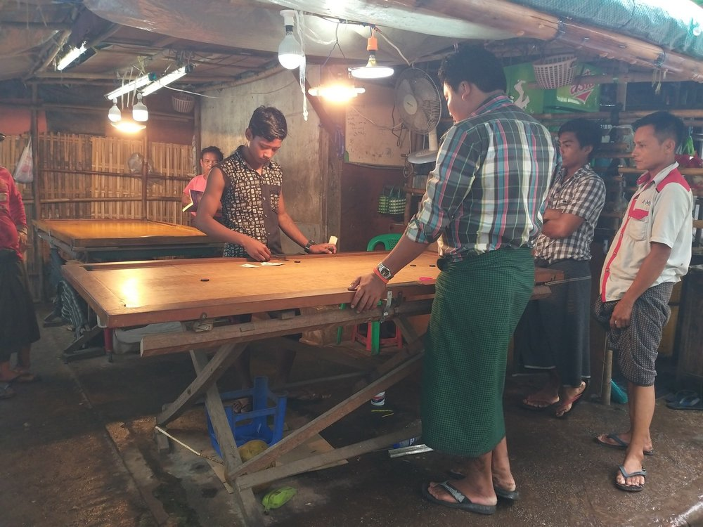 Inbetween shifts market workers chill playing carrom