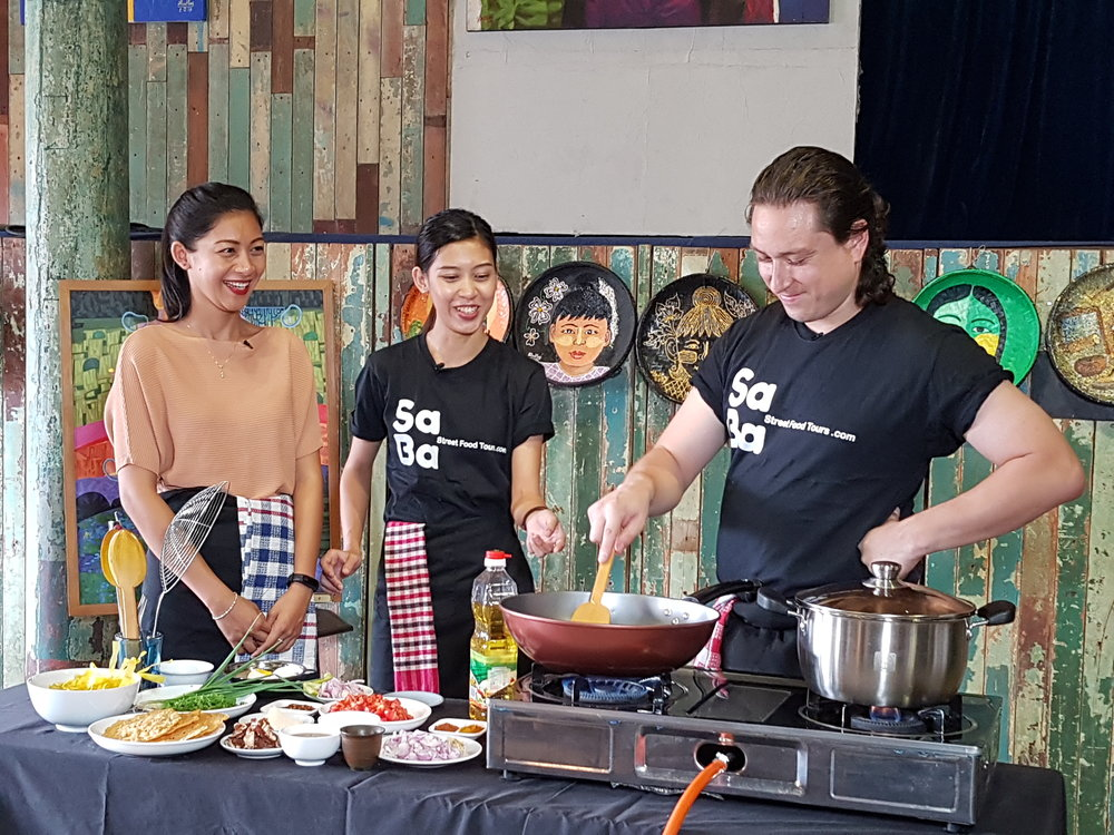 Cooking up some delicious traditional Myanmar dishes in Yangon cooking class and market tour