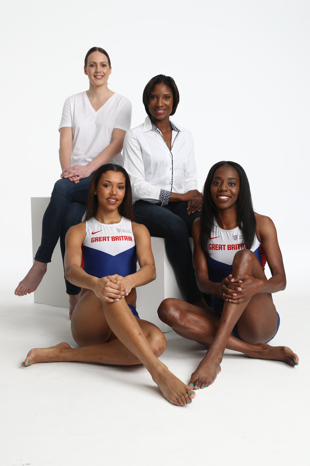 Olympic champion Denise Lewis and double Olympic bronze medallist Kelly Sotherton with two members of the British athletics team