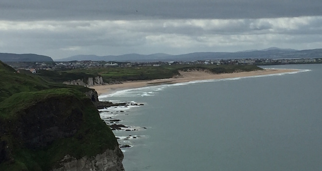 Golf from Afar --  In the distance, above the sandy beach, you can just make out Royal Portrush Golf Club in Northern Ireland. It will host the Open Championship in 2019 after a nearly 70-year hiatus.