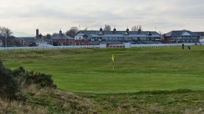 The Graves --That's the 2nd hole's given name as viewed here from the green looking back on its 348 yards. It's framed by the Musselburgh Racecourse grandstand in the background.