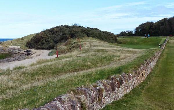 Stone Walled -- Here's the approach to the par 4 13th, guarded by an ancient wall that predates the links -- and now messes with your mind.