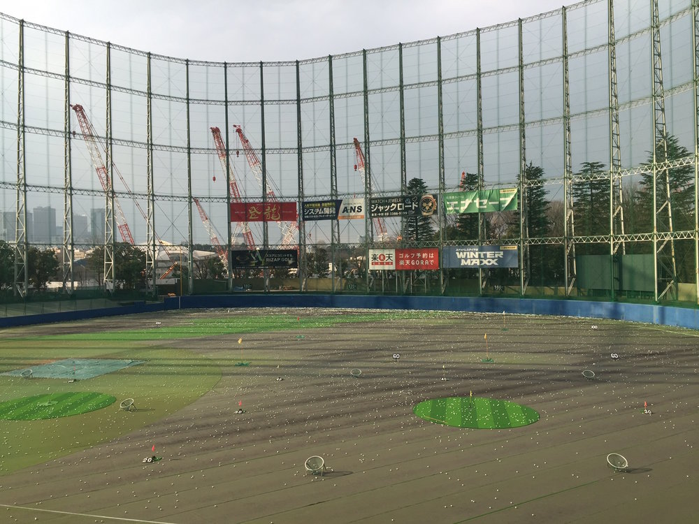 Swing for the Fences --  From my assigned stall on the third of four decks at the Jingu driving range in Tokyo, you can easily hit it over the wall but -- due to the netting -- not out of the park.