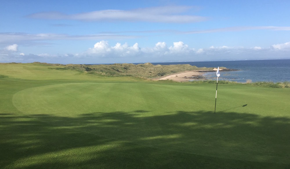 A Look Back --  Here's the view of the 10th from its green looking back toward the tee perched above the beach. Lovely!