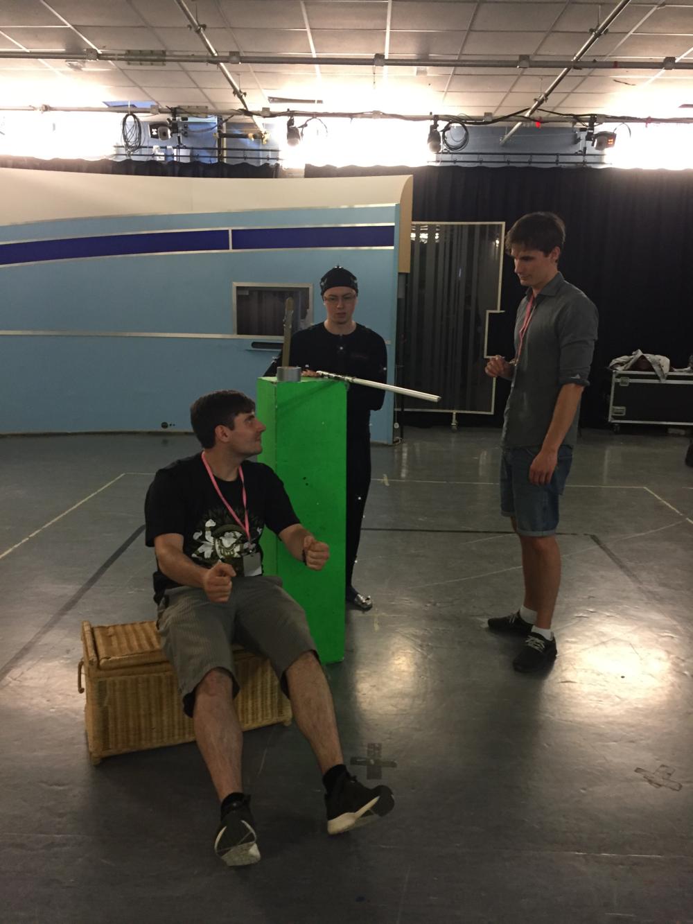 Nik hard at work on set...