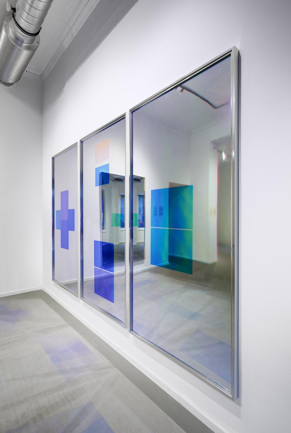 Spiegel im Spiegel -Installation view (2014) Acrylic foil on mirror beneath Radiant Plexiglas, aluminium frame structure.