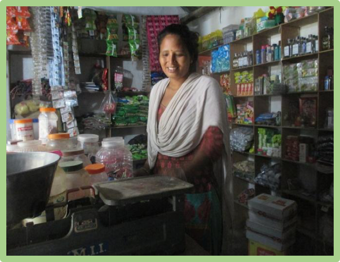 Ganga Debi smiles as she looks over her shop
