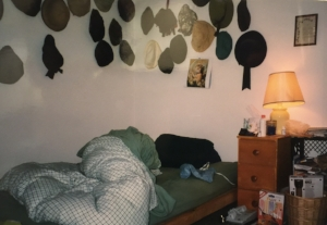 My 1990s bedroom. Check out the futon bed and milk crate shelf! And of course, the hat collection....wouldn't be me without my hats.