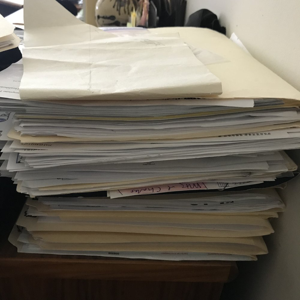 I need to find paperwork on my disability benefits for a phone meeting with a friend who is making sure I'm getting all the benefits available to me. this is Just one stack of my medical paperwork. Fun times!