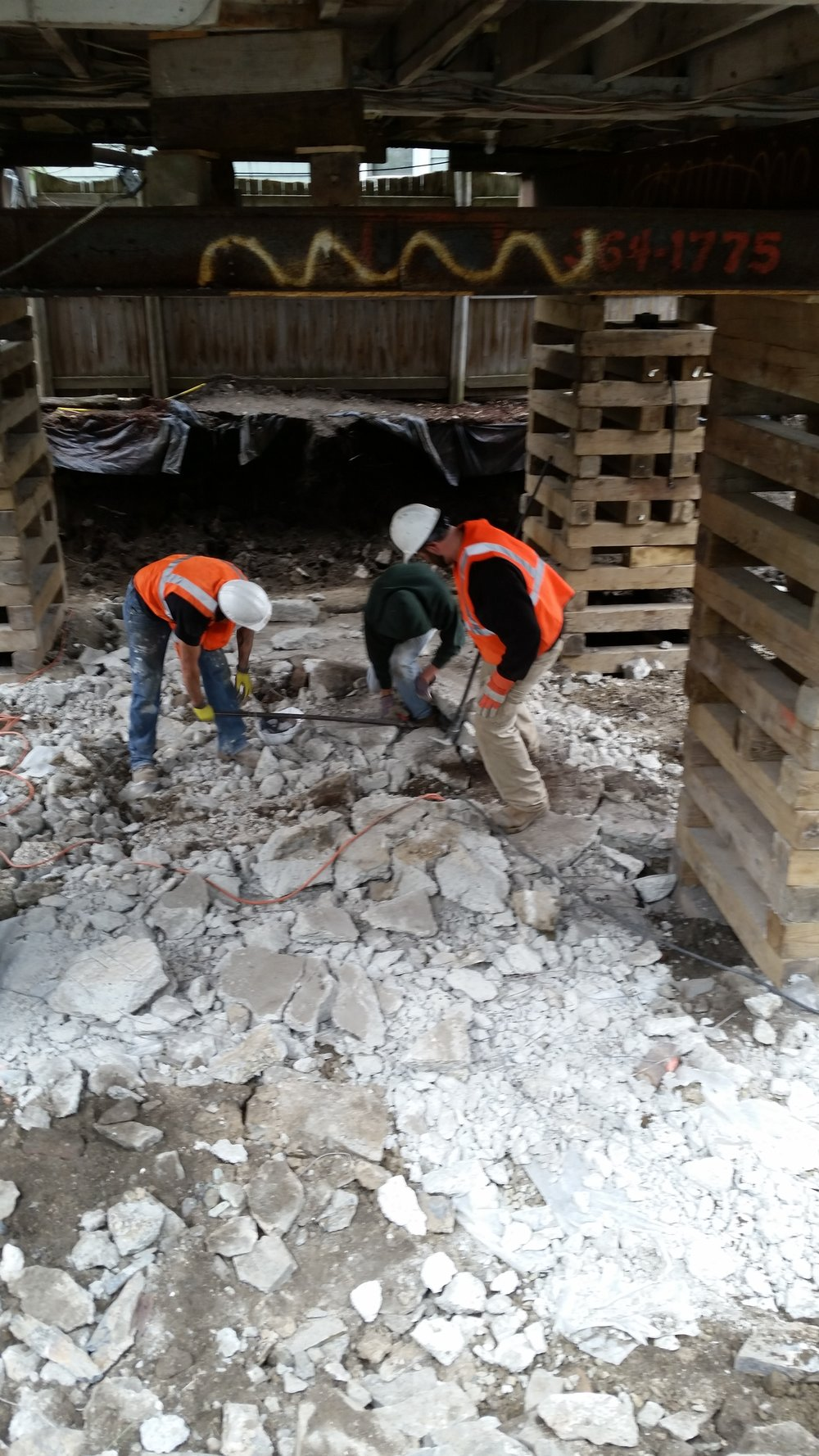 The most glamorous part of the job! The old foundation and slab floor are nearly gone.
