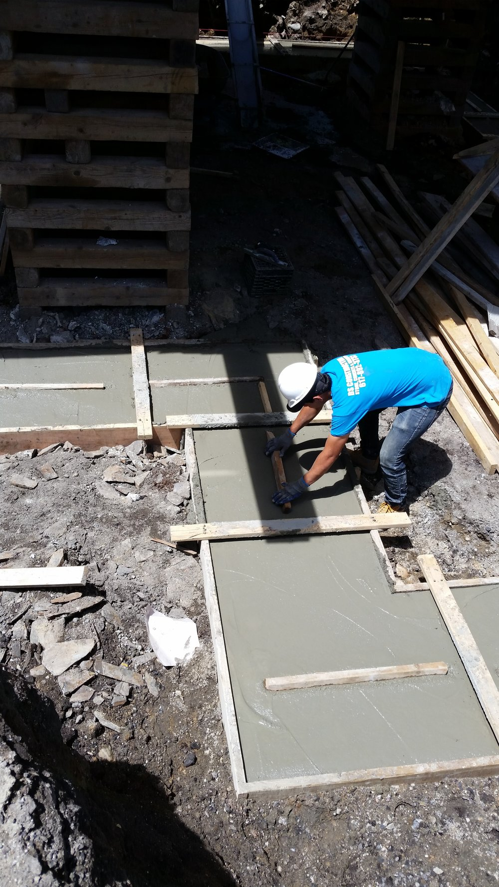 """Our staff then place wooden """"keyways"""" into the wet footings that ensure the foundation wall is locked into the footing when it gets poured."""