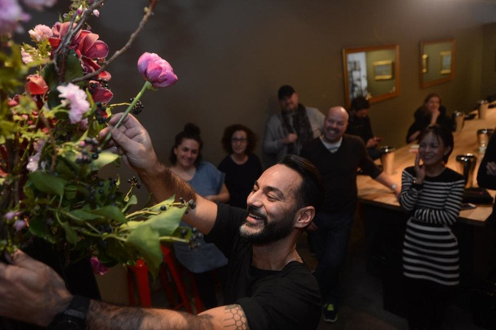 Oscar Mora shows how to put together a floral arrangement at FlowerSchool New York. (ANDREW SAVULICH/NEW YORK DAILY NEWS)