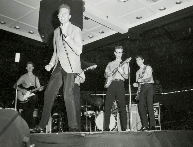 Jimmy Hannan and band playing at the Sydney Stadium - This concert photograph was taken by an unknown photographer at Sydney Stadium in 1965 and are a terrific example of Jimmy's popularity and vitality. Jimmy remembers this particular concert at Sydney Stadium where he performed alongside Johnny Devlin, Little Pattie and The Denvermen, recalling that you were 'very lucky to be heard above the screaming'. Jimmy looks very relaxed in his role as a teen idol, managing to look casual even in a suit jacket and tie.