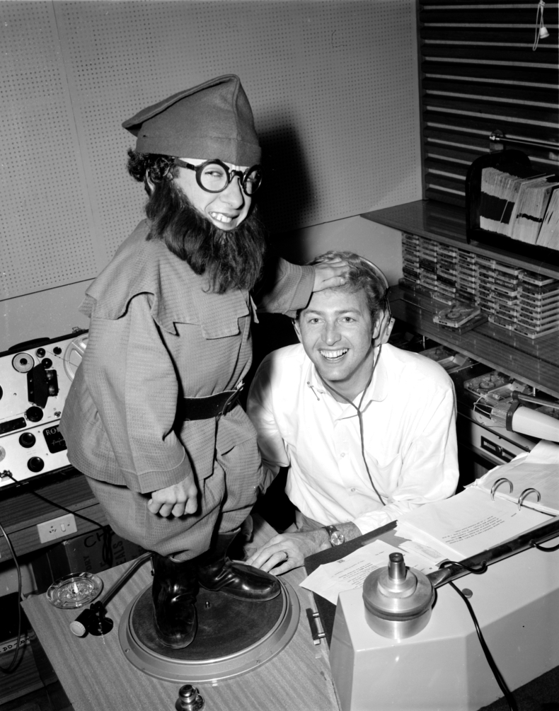 Christmas Collection - Jimmy Hannan and a Christmas elf performer in the 3UZ studios, 20 December 1968. Laurie Richards Collection. Performing Arts Collection, Arts Centre Melbourne.