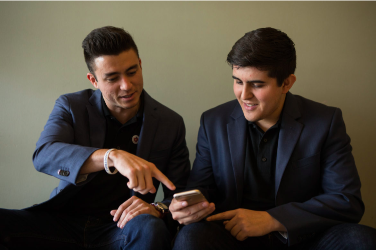 Our Co-Founders Miles (left) and Matt (right) showing Rivard Report the concept of CafeEDU during their interview! (June 8, 2018)