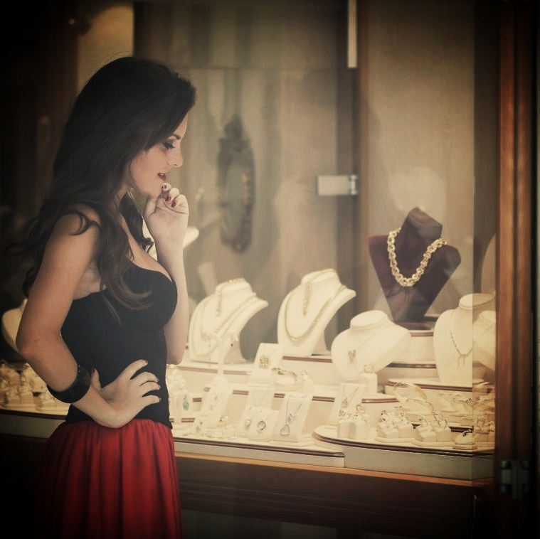 woman-looking-at-necklaces-in-store.jpg