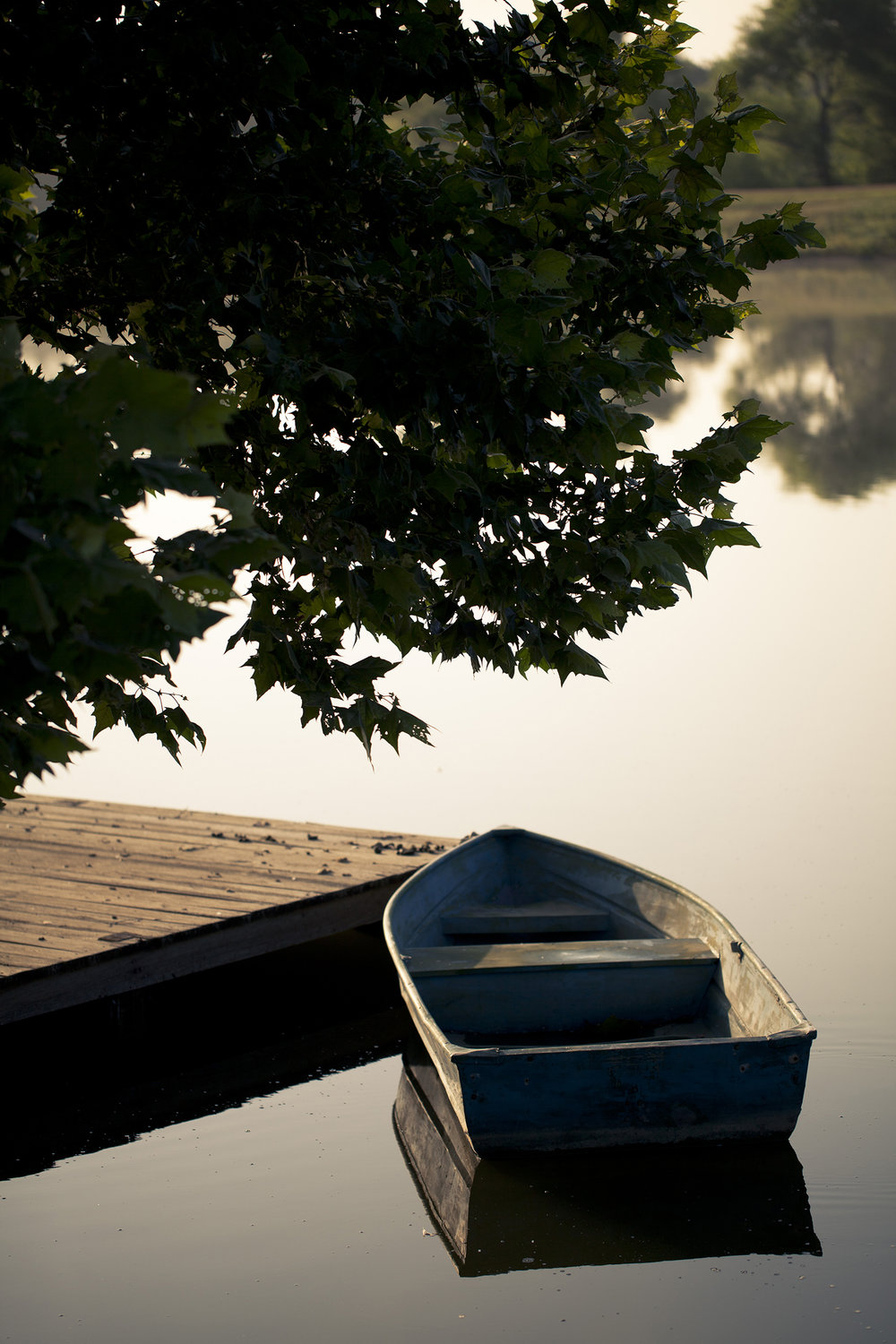 An antique boat docked at StarHill Pond