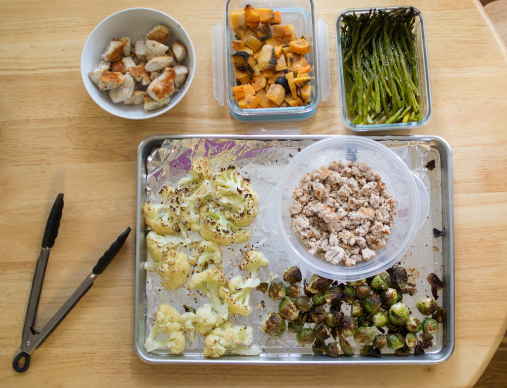 Pictured Here: Roasted Cauliflower, Brussel Sprouts, Butternut Squash, Ground Turkey, Asparagus, and Grilled Chicken.
