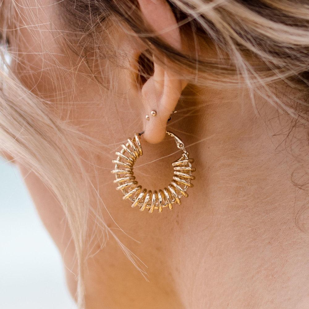 gold hoop earring reliquia.jpg