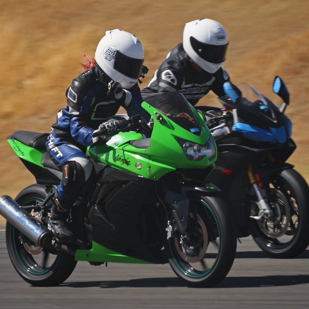 Toni and Michael on the straight of Thunderhill West during a 5-Mile day with Fun Track Dayz