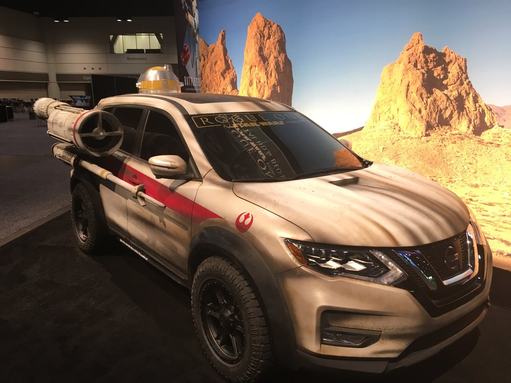 Photo of the Nissan Rogue on setup day that displayed throughout the event. Question: how do you get in it?