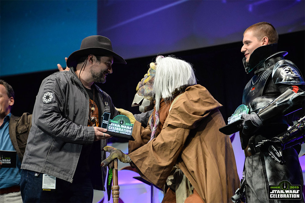 Dave Filoni with costumed guests on Celebration Stage