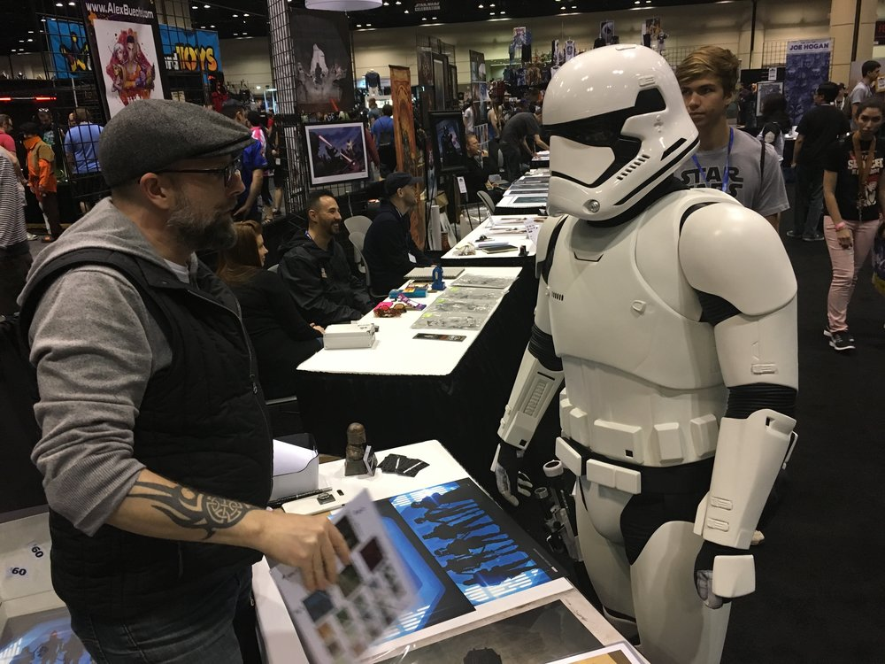 "Christman meets Christman. Stormtrooper TK-91488 Preston ""Pretzel"" Christman of the 501st Legion comes by the booth to get a personally autographed print from a presumed to be ""distant cousin"" far, far away. The discussion lasted a while. Apparently half the state of Pennsylvania is named Christman... or so the story goes."