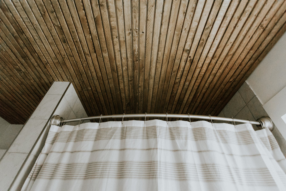 SLATTED CEILING IN THE BATHROOM