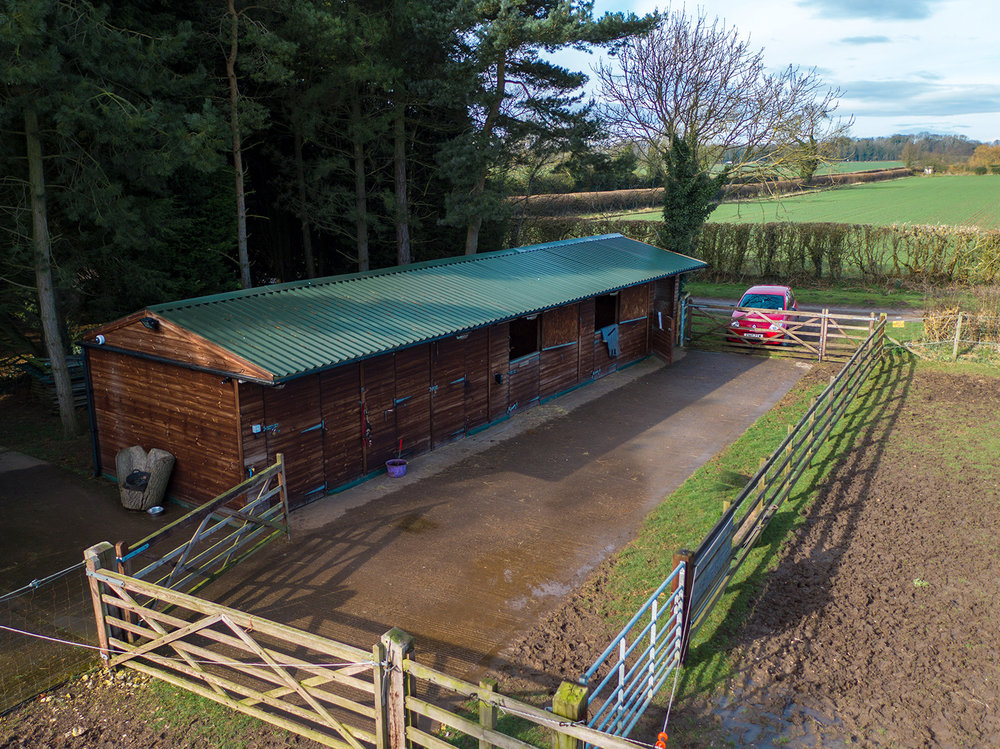 wide shot of stables