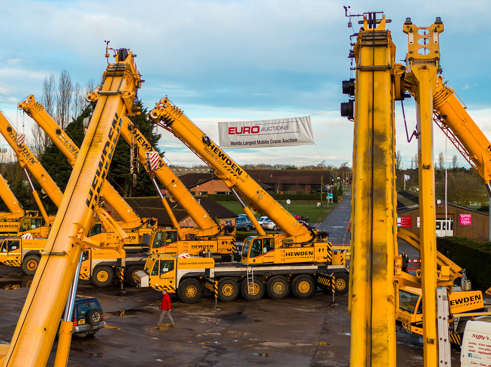 euro auctions banner with cranes