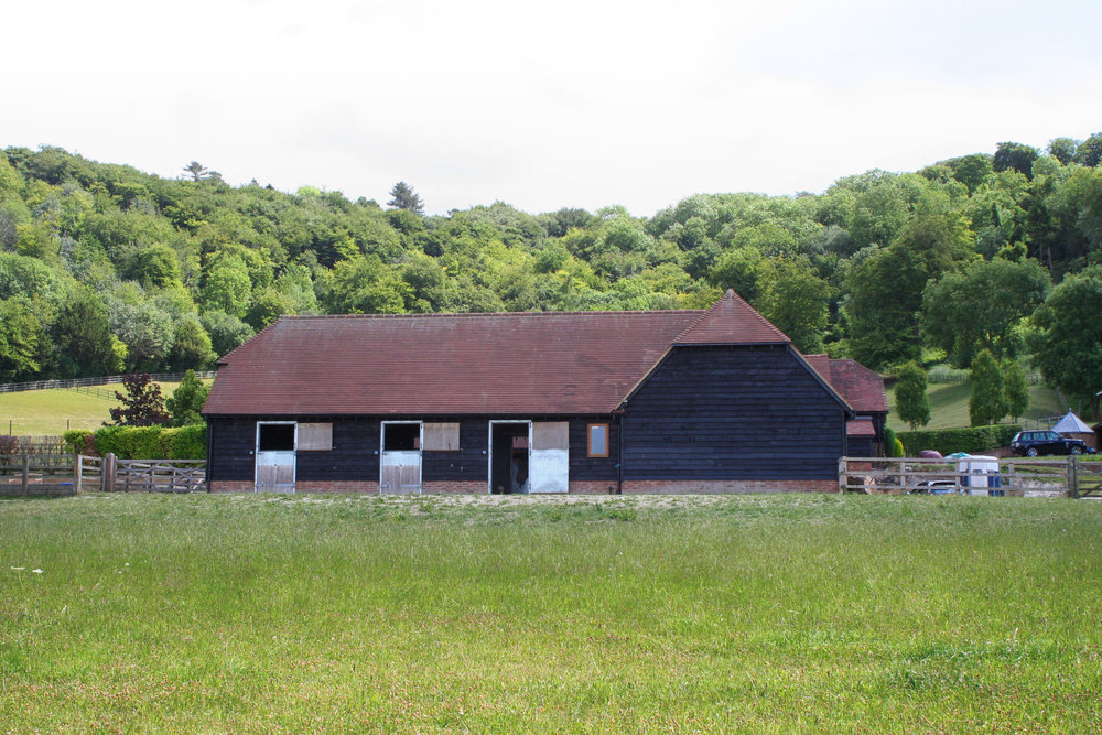 Loose boxes, machinery storage and hay/tack room