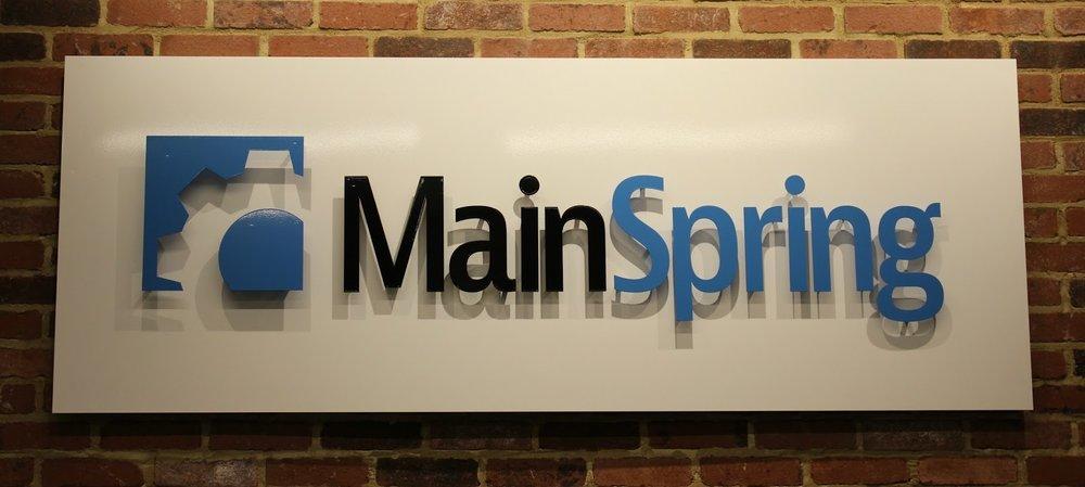 Main Spring logo sign lobby.jpg