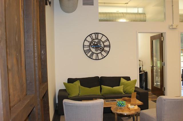 lobby with clock file room doors.jpg