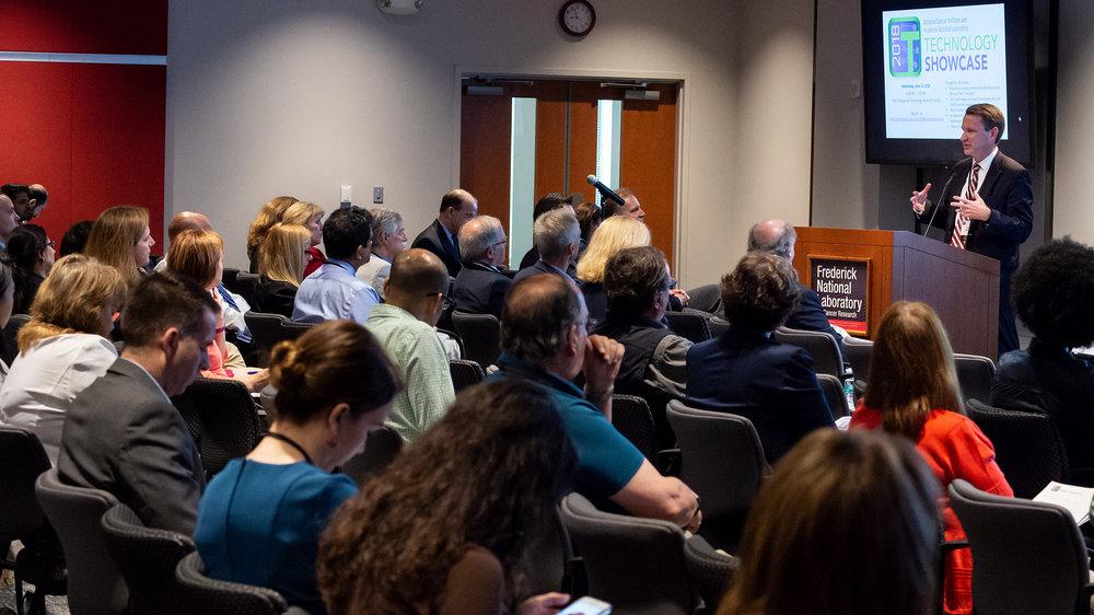 NCI Director Ned Sharpless addresses Technology Showcase 2018, Frederick MD.Photo courtesy Frederick National Laboratory for Cancer Research. Richard Frederickson, photographer.